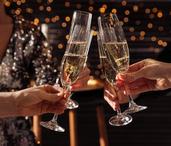 People,Clinking,Glasses,Of,Champagne,Indoors,,Closeup